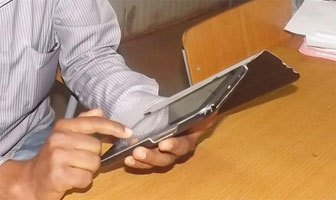 A student using e-reader tablet